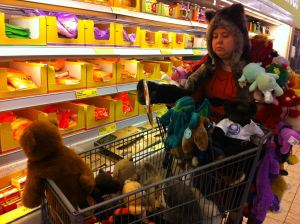Item #69: You and a friend must take at least 50 of your stuffed animals/dolls on a field trip to a grocery store. (Pictured: my friend Kate)